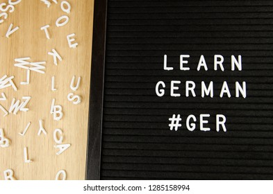 learn German language sign on black background with hashtag