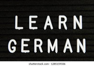 learn German language sign on black background