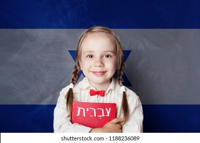 Learn hebrew language. Smart child girl on Israel flag background