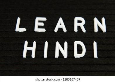 learn Hindi, Indian language, sign on black background