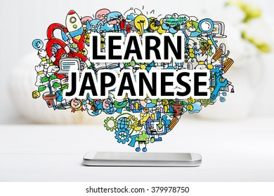 Learn Japanese concept with smartphone on white table