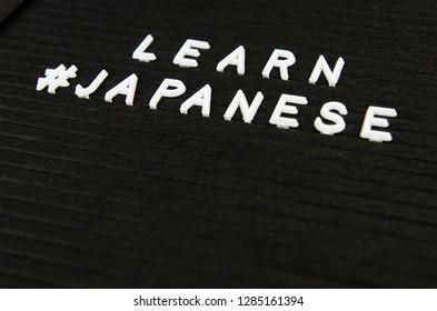 learn Japanese language sign on black background