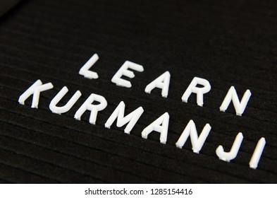learn Kurmanji, Nothern Kurdish language sign on black background