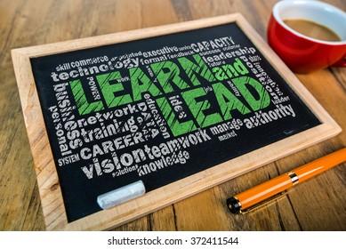 learn and lead word cloud on small blackboard