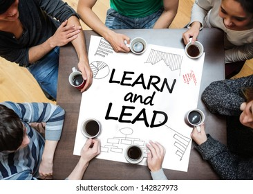 Learn and lead written on a poster with drawings of charts during a brainstorm