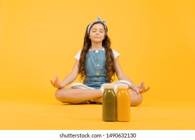 Learn meditating techniques. Stay positive and optimistic. Healthy way of life. Yoga training. KId girl sit meditate. Meditating practice. Good vibes. Peaceful meditating. Vegetarian smoothie drink.