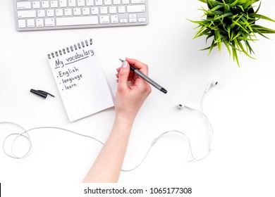 Learn new english vocabulary. Learn landuage concept. Computer keyboard, notebook for writing new vocabulary on white background top view