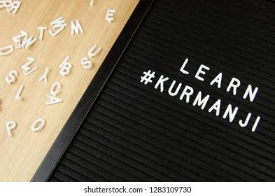 Learn Northern Kurdish Kurmanji language, KUR abbreviation, simple sign on black background, great for teachers, schools, students