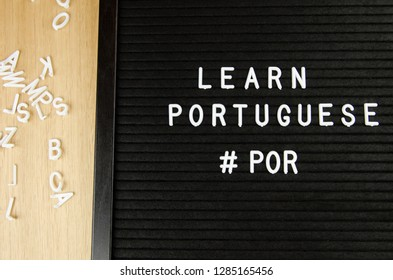 learn Portuguese language sign on black background