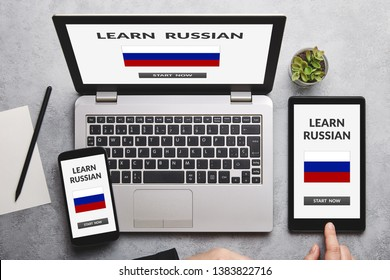 Learn Russian concept on laptop, tablet and smartphone screen over gray table. Flat lay
