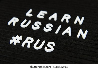 learn Russian language sign on black background, hasthtag