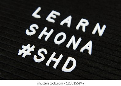 learn Shona, SHD, Zimbabwe language sign on black background