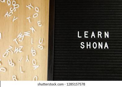learn Shona, Zimbabwean language sign on black background