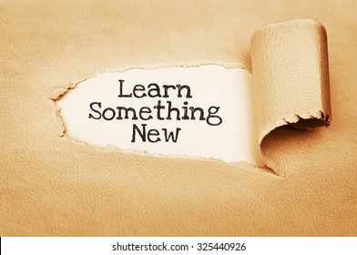 Learn Something New message text written behind a torn paper