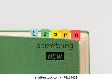Learn something new - textbook with back to school motivational quote