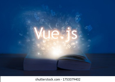 Learn Vue.js. Light coming from open book with words vue js. Education concept. Learn programming language