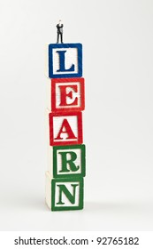 Learn word and toy business man