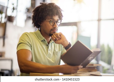 Learn for your better tomorrow. Young student in library. - Shutterstock ID 1410451523