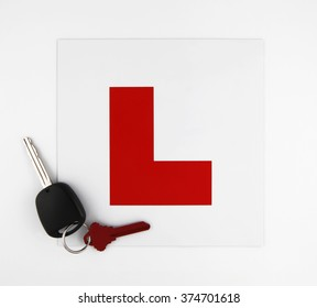 Learner Plate with Car Keys on White Background