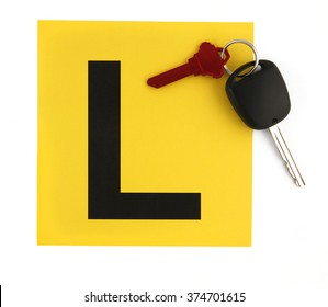 Learner Plates with Car Keys on White Background