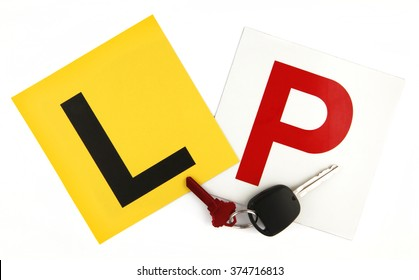 Learner & Probation Plates with Car Keys on White Background