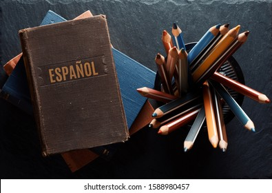 learninf Spanish concept. Old books and pencils