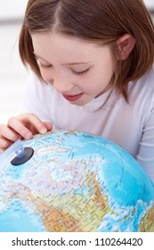 Learning about the world - young girl with earth globe