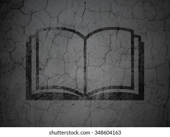Learning concept: Black Book on grunge textured concrete wall background