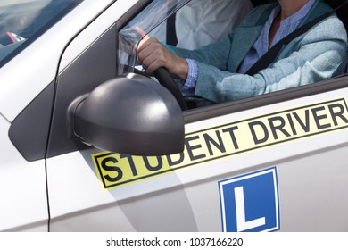 Learning to drive a car with a driving instructor. Student driver.
