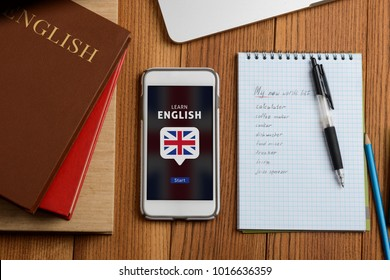 Learning English concept. Student books and online app. Improving speaking and expanding vocabulary, becoming an exchange student.