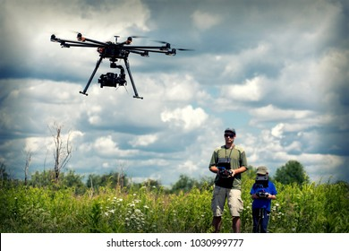 learning to fly a drone, father trains son piloting drone