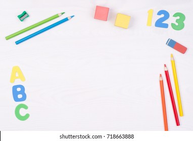 Learning how to read, write and count. Kid's desk with colorful letters, numbers and pencils, top view with copy space