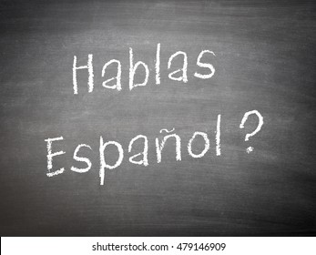 Learning language Spanish concept on a blackboard with the words Hablas Espanol?