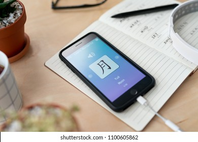 Learning mandarin chinese from online lesson, digital mobile cellphone app application education on the go