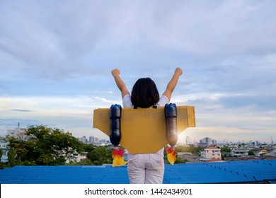 Learning new things, Child pretend to be businessman. Kid playing at home. Imagination, idea and creative concept. The girl who has a year of swagger flying over the city, Business advantage concept.