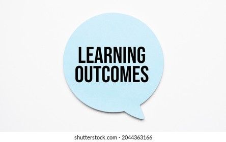 Learning outcomes speech bubble and black magnifier isolated on the yellow background.
