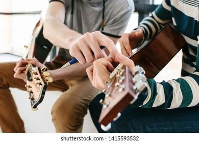 Learning to play the guitar. Extracurricular activities or tutoring or hobbies or creative activities.