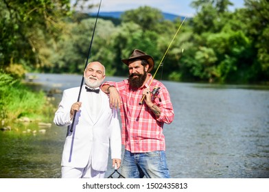 Learning from the professional. hobby of businessman. retirement fishery. friends men with fishing rod. Fly fishing adventures. happy fishermen in water. retired father and mature son with beard.