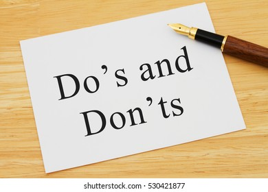 Learning to use proper grammar, A white card on a desk with a pen with words Do's and Don'ts