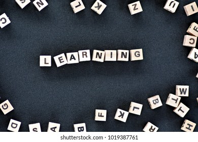 learning written with wooden cubes