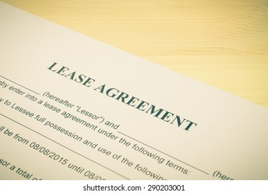 Lease Agreement Contract Document Left Angle View on Wood Table in Vintage Style. Legal document for business event