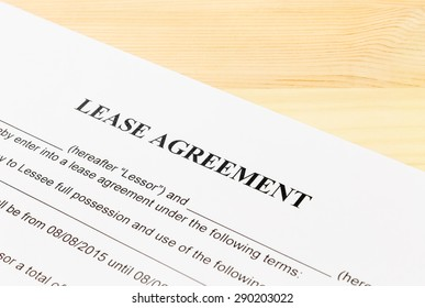 Lease Agreement Contract Document on Wood Table Left Angle View. Legal document for business event