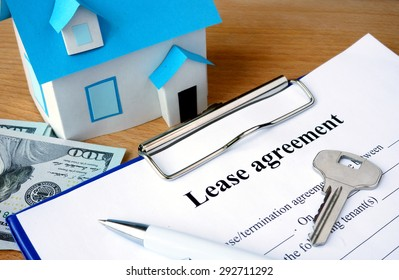 Lease agreement document with dollars and home model.