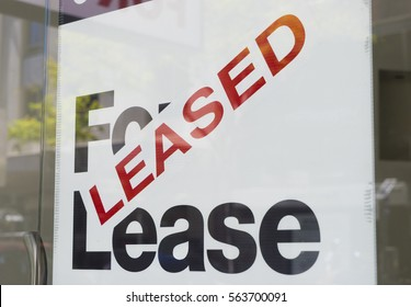 For lease and leased sign on display outside a building