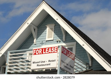 A for lease sign on the porch area of a house