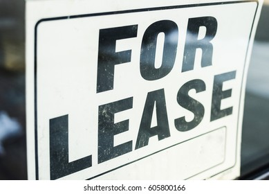 For lease sign in store front window.