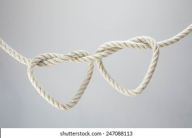 leash  rope into heart shape on white background