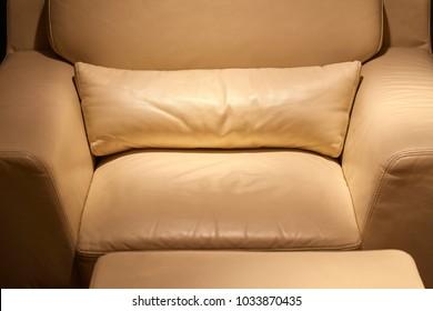 Leather armchair detail, cozy dim environment