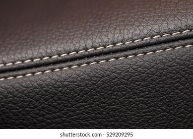 Leather background. Detail of car interior. Macro.