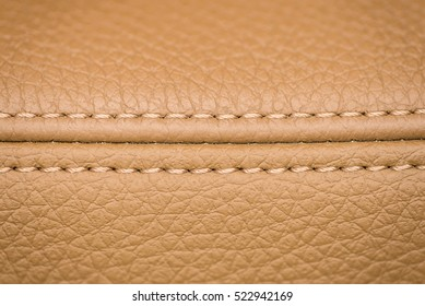 Leather background. Detail of car seat. Macro.